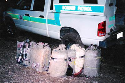 Backpacks of drugs carried by illegal aliens on Barnett Ranch